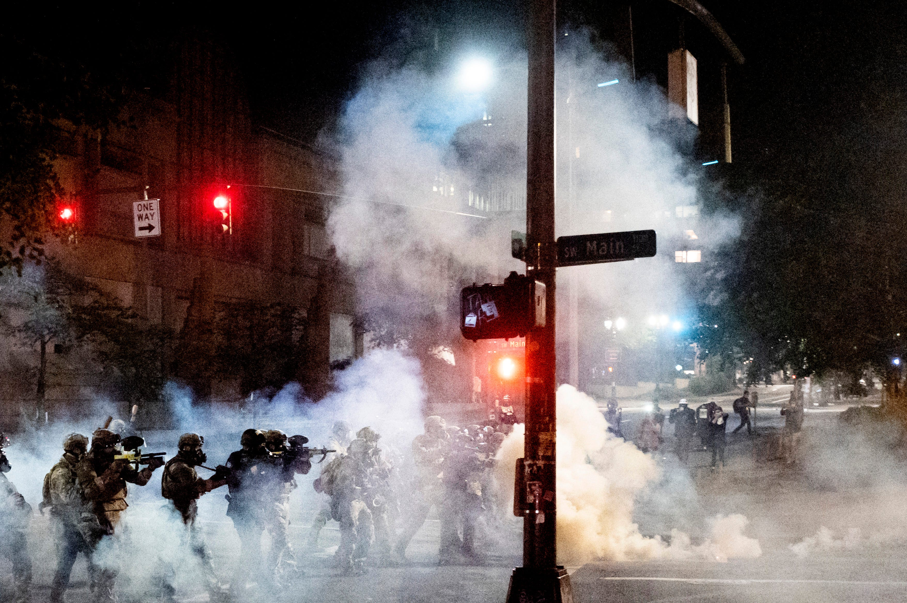 Federal agents use crowd control munitions to disperse Black Lives Matter protesters near the Mark O. Hatfield United States Courthouse on Monday, July 20, 2020, in Portland, Oregon.
