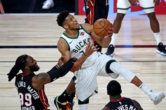 Bucks forward Giannis Antetokounmpo drives to the basket during Game 3.