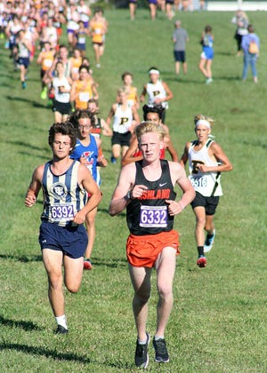 Ashland High's Dylan Hickey leads the pack during the Ashland Invitational Saturday at Freer Field.