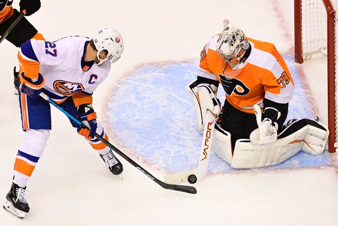 Flyers goalie Carter Hart makes the save on the Islanders' Anders Lee during Game 7 on Saturday night.