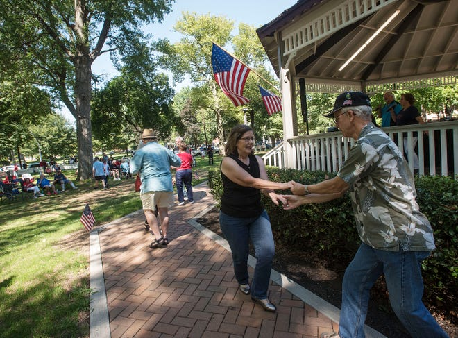 Jeff Zaharko and Debbie Dunn of Greentree dance to the band Voices during a combined Support Our Troops and Let's Roll/Never Forget 9/11 rally Saturday afternoon at Irvine Park in Beaver.