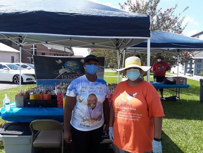 Volunteers distribute free school supplies Saturday at St. Luke Community Center in Thibodaux.