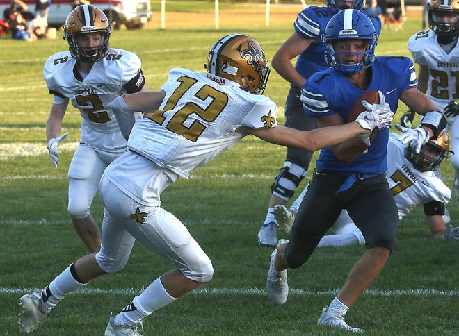 Buckeye Trail's Franko Rome bust through Tuscarawas Central Catholic's Jordan Heaston in the first quarter of the game at Tuscarawas Central Catholic Saturday.