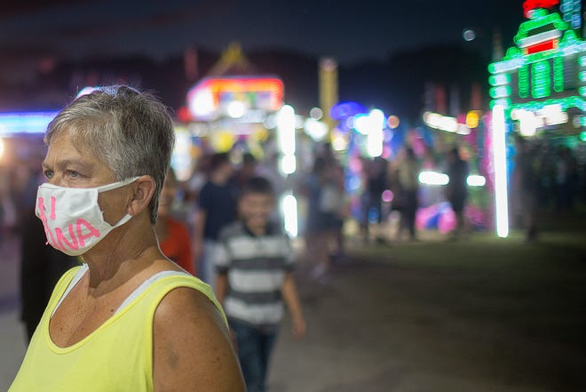 Melody Sharpe wears a mask as she attends the Maury County Fair and Exposition in Columbia, Tenn., on Saturday, Sept. 5, 2020.