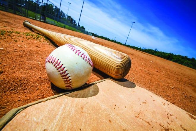 Baseball bat and ball, set down at home plate.