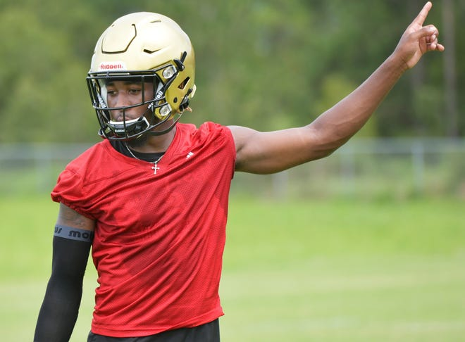 Oakleaf quarterback Walter Simmons III lines up for a drill during practice. Simmons, who has committed to East Carolina, enters his fourth season as the Knights' starter.