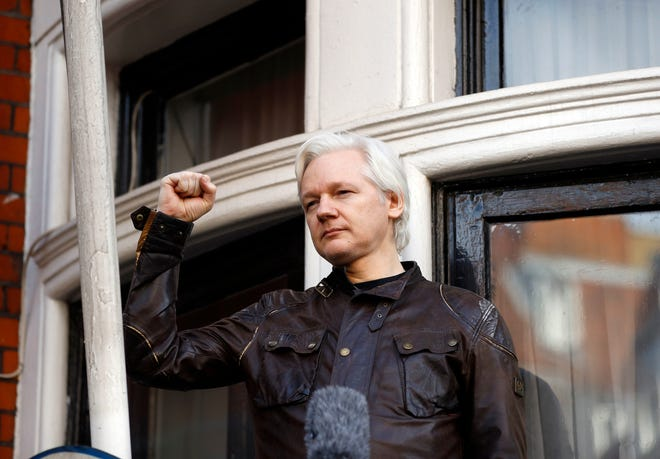 Julian Assange greets supporters outside the Ecuadorian embassy in London in May 2017. WikiLeaks founder Assange is set to fight for his freedom in a British after a decade of legal drama, as he challenges American authorities' attempt to extradite him on spying charges over the site's publication of secret U.S. military documents.