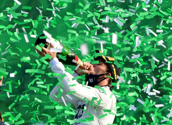 AlfaTauri driver Pierre Gasly of France celebrates on the podium after winning the Formula One Grand Prix at the Monza racetrack in Monza, Italy, on Sunday.