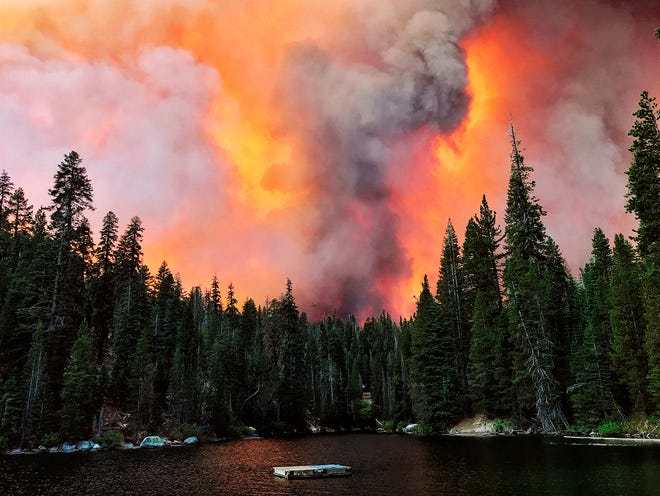 Smoke from the Creek Fire billows beyond a ridge as seen from Huntington Lake. [ERIC PAUL ZAMORA/THE FRESNO BEE VIA AP]