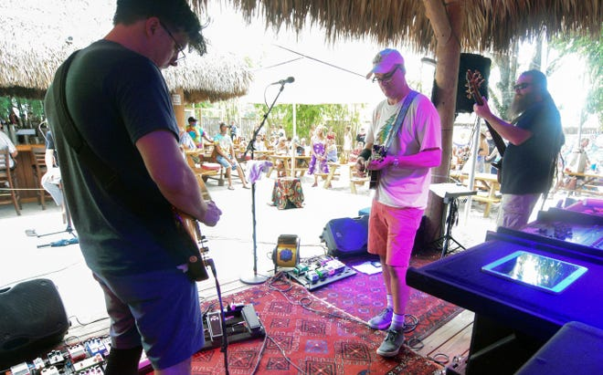 Ship of Fools, with Nate Howell on guitar, left, Turner Moore on mandolin and Mike Hoffman on bass, perform Sunday at Stottlemyer's  Smokehouse in Sarasota.