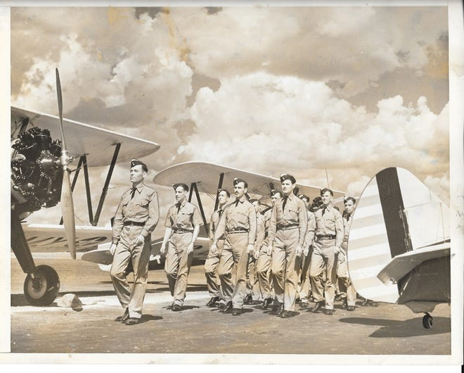 RAF Cadets, 1941:Cadets from the British Royal Air Force march to their Army training planes at Hargrove Van de Graaff Airport, June 10, 1941, as they prepare to begin their instruction by pilots of the Alabama Institute of Aeronautics.