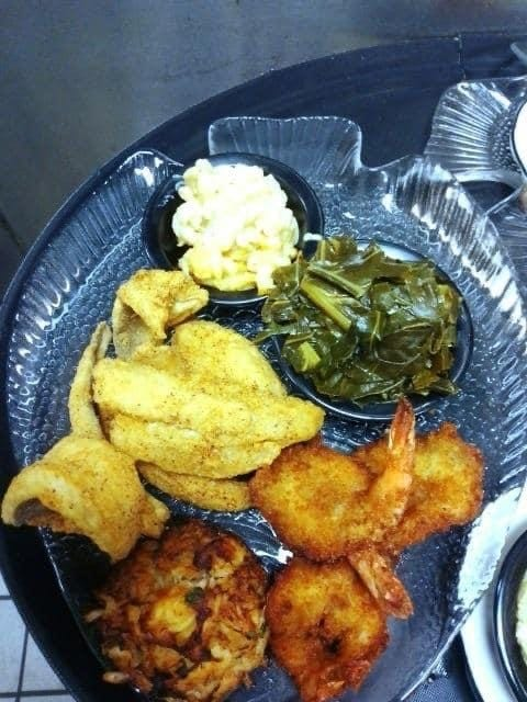 Fried fish, shrimp, crab cakes, greens and more are shown at Rochester's Barbecue & Grill in Lawnside.