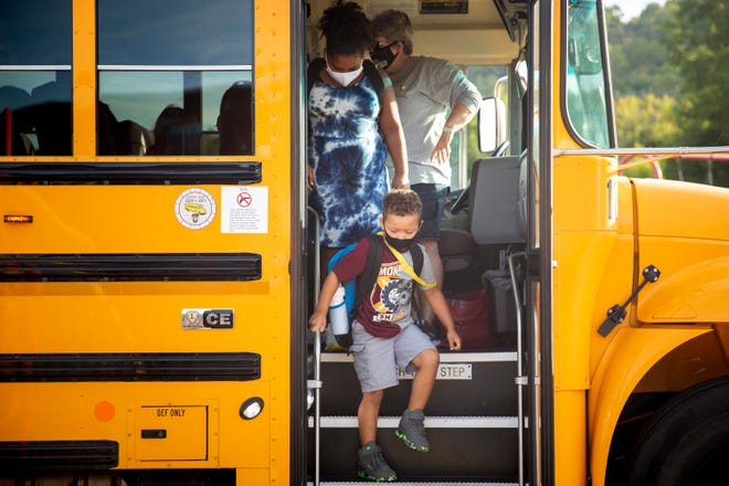 Students get off the bus at Three Rivers School Elementary in Cleves on Friday, September 4, 2020.
