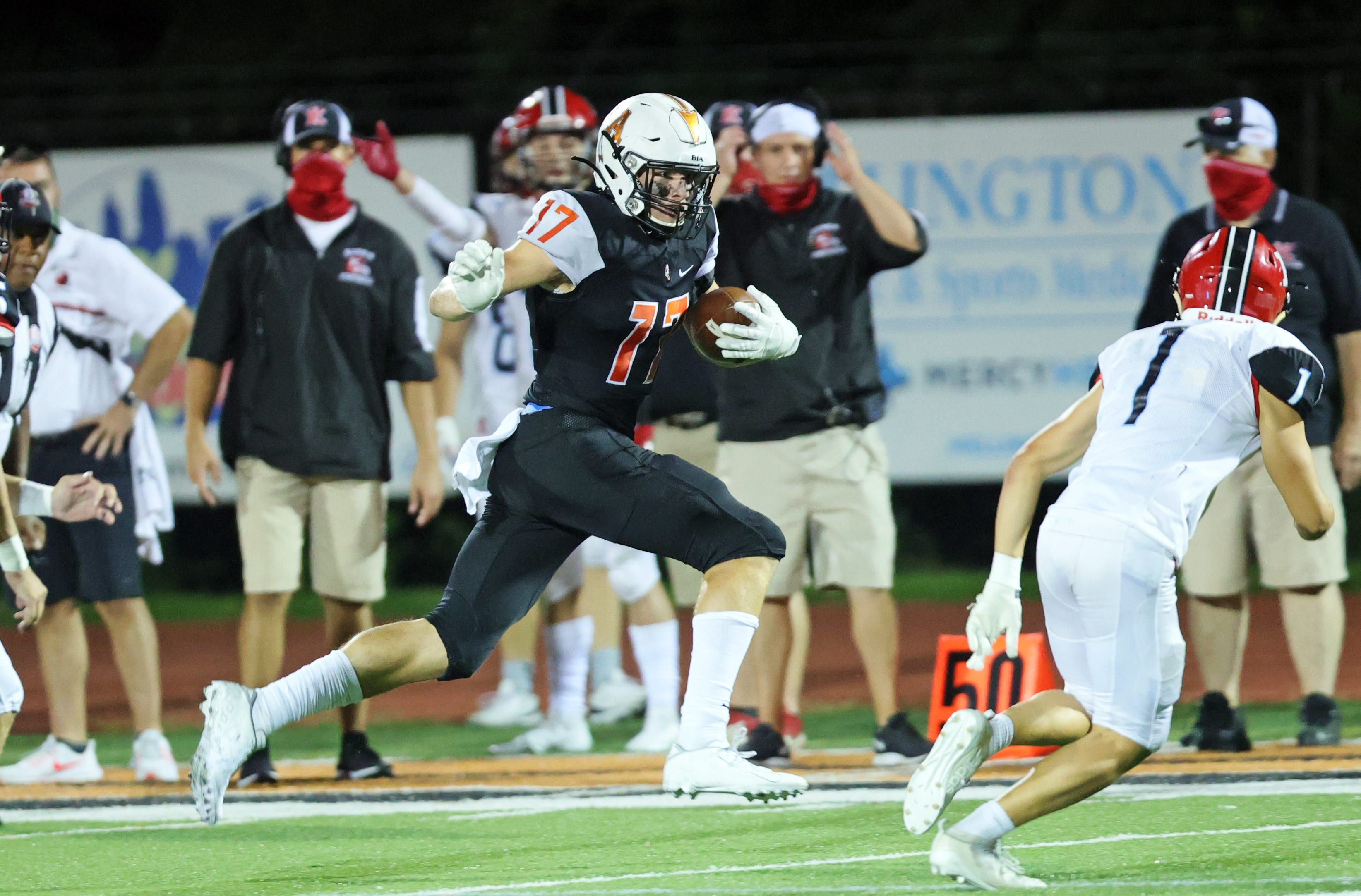 Anderson wide receiver Brody Foley runs for a long gain after a catch in the game between Kings and Anderson high schools at Anderson Sept. 5, 2020.