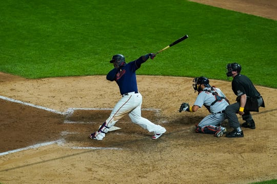 Minnesota Twins first baseman Miguel Sano hits an RBI single in the ninth inning against the Detroit Tigers at Target Field, Sept. 5, 2020.