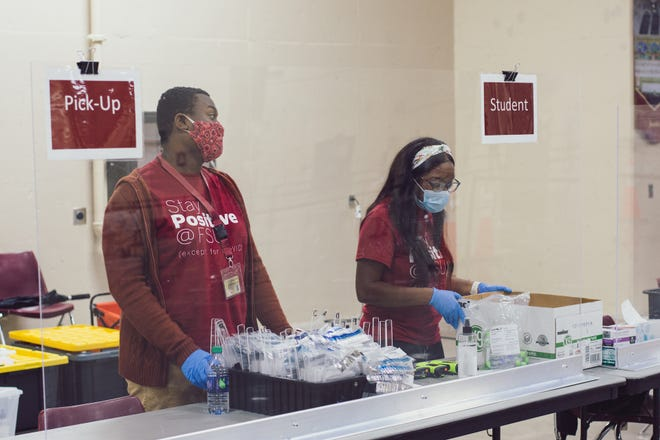 Student volunteers work at the FSU COVID-19 testing site at the Donald L. Tucker Civic Center.