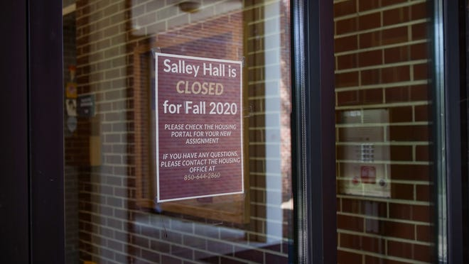 A sign on the door of Salley Hall warns students that the dorm is closed to visitors. Students who test positive for COVID-19 must quarantine in either Salley or Rogers Hall during the fall semester.