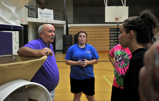 Del Barr, left talks to potential Millersport girls basketball players when he was hired in 2014. Barr, who led the Liberty Union girls basketball to a 28-0 record and the 1993 state championship, passed away Saturday night.
