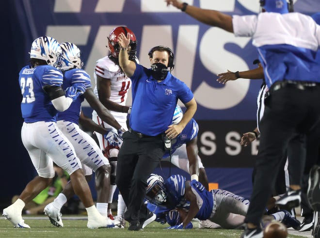 Memphis Tigers Head Coach Ryan Silverfield celebrates an interception by Sylvonta Oliver during their game against Arkansas State at Liberty Bowl Memorial Stadium on Saturday, Sept. 5, 2020.