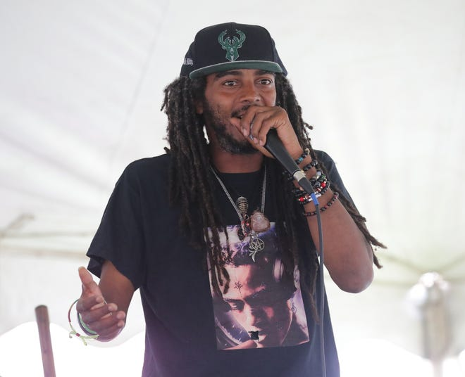 Milwaukee protest leader Frank Sensabaugh, who goes by the name Frank Nitty, speaks during a Peace in the Streets rally.