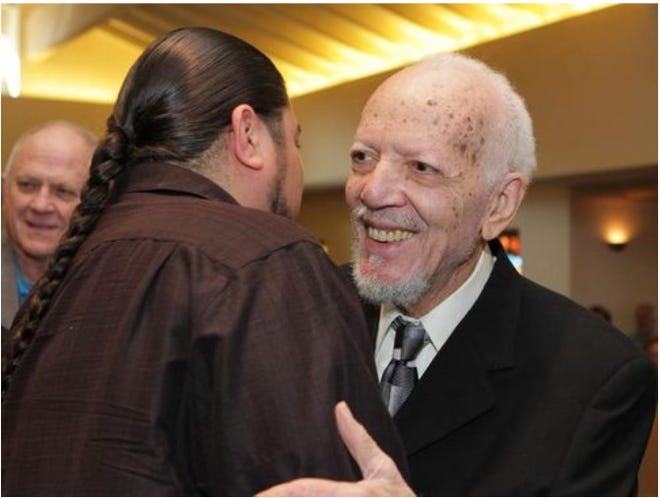 Joseph Beaver, the founder of the Palm Springs Black Historical and Cultural Society and former chair of the Martin Luther King, Jr. Commemoration Committee hugs well wishers as he is honored during the Martin Luther King, Jr. commemoration celebration at the Church of St. Paul in the Desert in 2014.