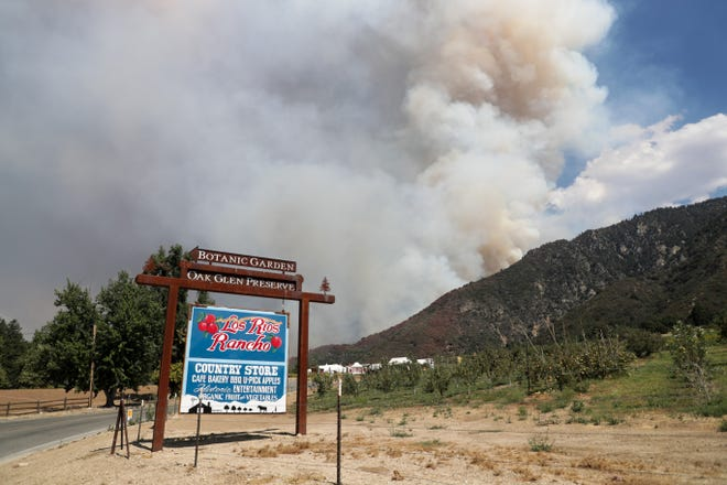 A sign for Los Rios Rancho sits in front of the El Dorado Fire near Oak Glen, Calif., on Sunday, September 6, 2020.