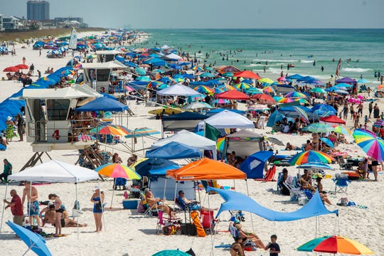 Pensacola Beach visitors on Sunday take advantage of the beautiful weather over the Labor Day weekend.