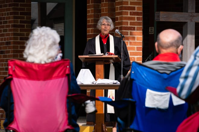 The Rev. Roxie Davis presides over a social-distanced church service Sunday, Sept. 6, 2020, at First Presbyterian Church Port Huron.