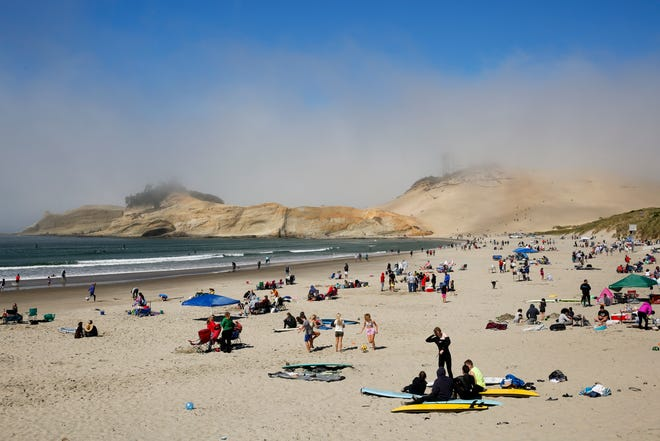 People scatter the beach during Labor Day weekend on Sunday, Sept. 6, 2020 in Pacific City.