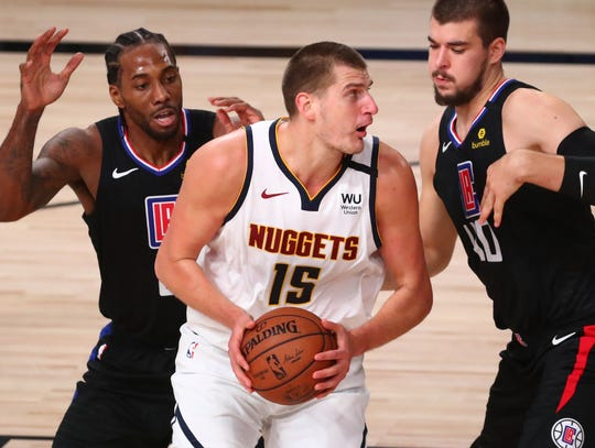 Nikola Jokic (15) had 26 points and 18 rebounds for the Nuggets.