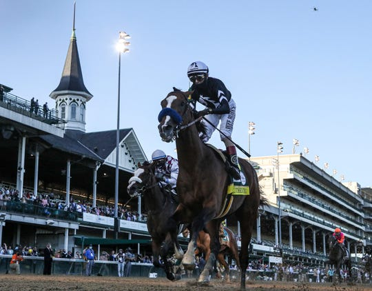 Jockey John Velazquez rides Authentic to the win at the 146th Kentucky Derby on Saturday.