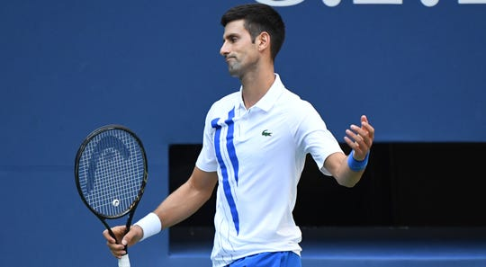 Novak Djokovic reacts during his match against Pablo Carreno Bustaports.