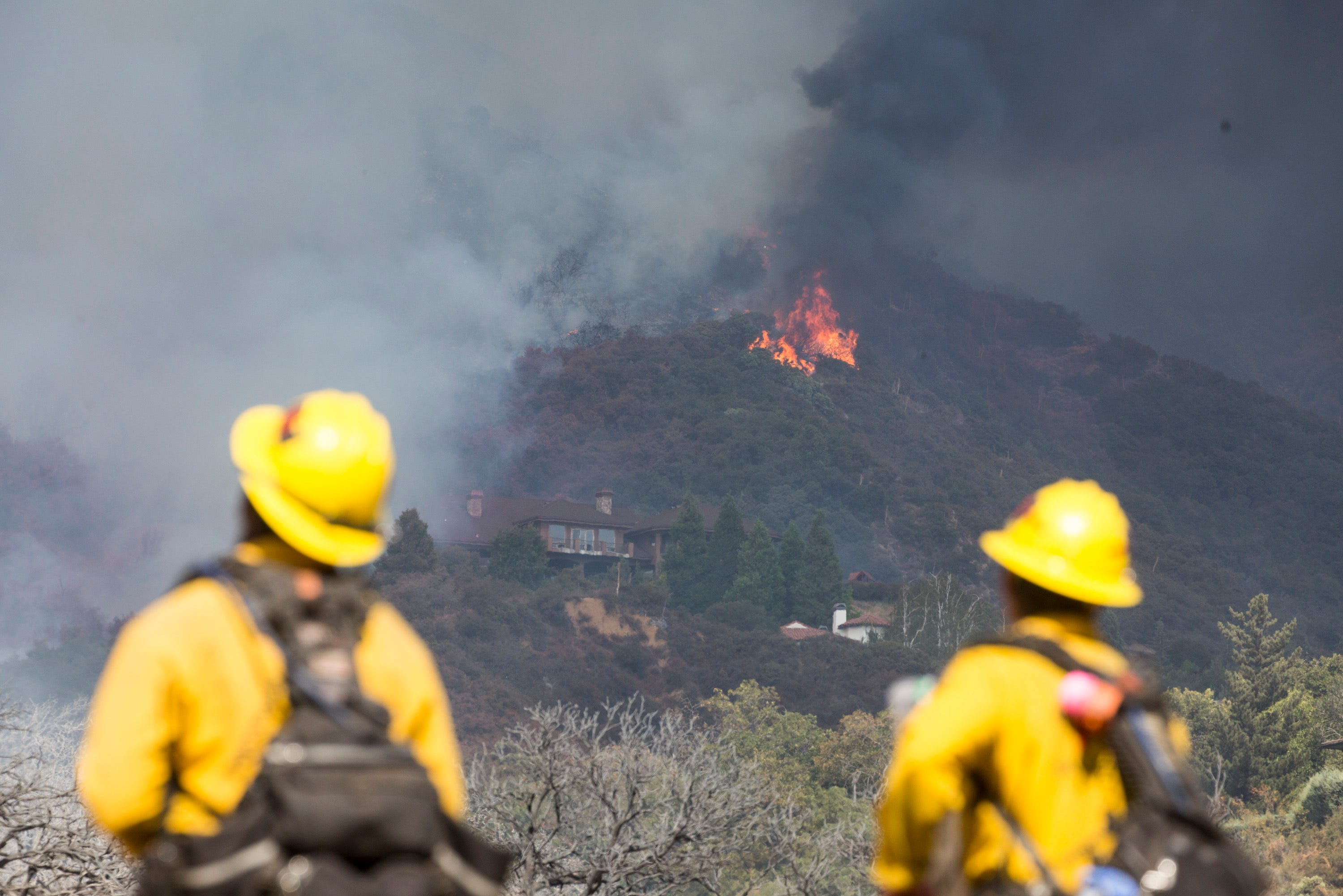 Fast-moving wildfires erupt amid heat wave in California