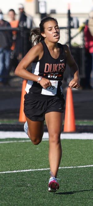 Marlington's Bella Graham placed first overall in the girls race at the 2020 Ashley White Cross Country Invitational held at Marlington High School on Saturday, September 5, 2020.