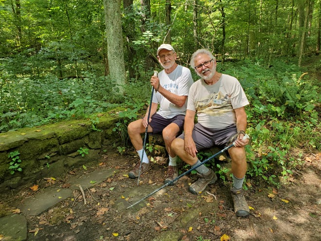 Mohican Trails Club members Gary Greunke, left, and Glenn Ertel pause by one of two old Civilian Conservation Corps shelter house foundations along the new (and old) Gorge Overlook Trail.