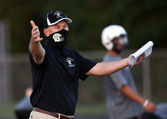 Quaker Valley High School head football coach Ron Balog gestures to his team during practice on Sept. 3.
