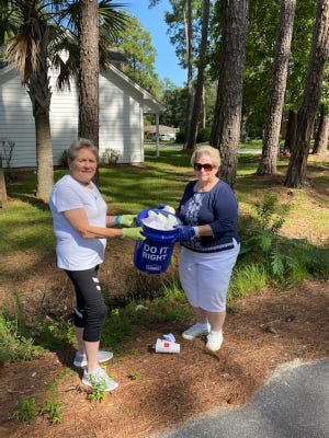 Josephine Boyles, left, and Hilda Horton participate in the Grab a Bucket challenge. The challenge is being held to help rid Jasper County of litter.
