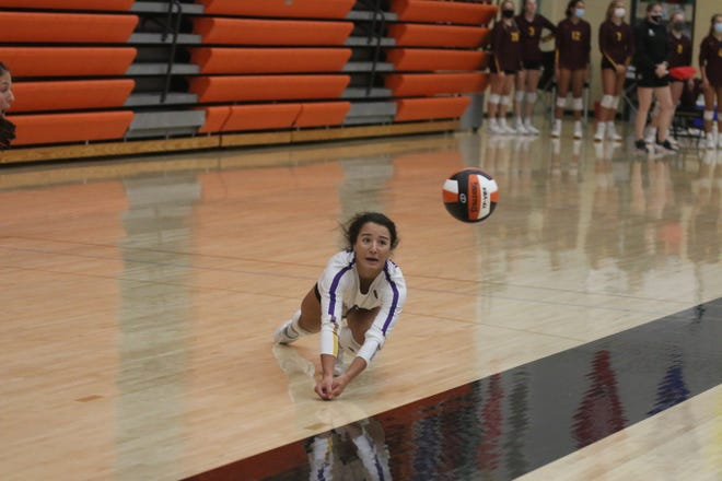 Waukee's Kori Knox dives for a ball in the Valley tournament on Saturday, Sept. 5 against Dowling Catholic.