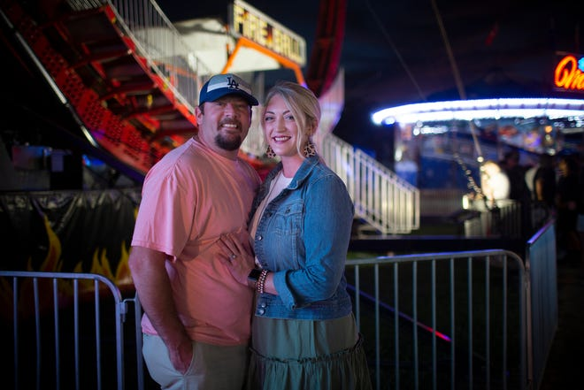 Blair Keeling and Lacey Keeling visit the Maury County Fair and Expo held at the Maury County Park in Columbia, Tenn., on Saturday, Sept. 5, 2020. The couple first met at the park 15 years earlier and now have four children.