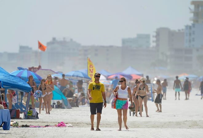 New Smyrna Beach was filled with visitors enjoying the nice weather Monday to celebrate the Labor Day holiday.