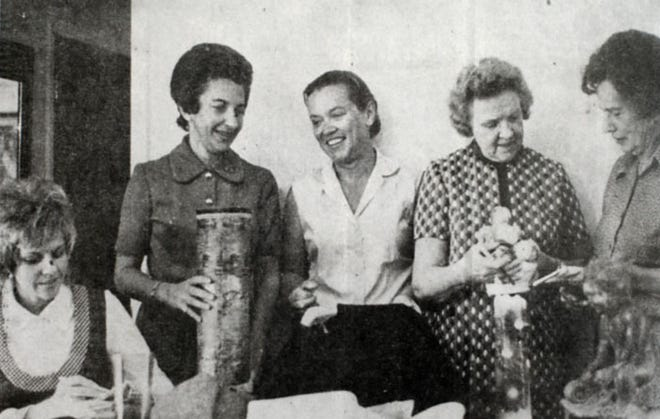 A photo in a Hetta Gilbert scrapbook from Sept. 1972 shows members, from left, Mrs. Robert Hansen, Mrs. Irvin Stein, Mrs. John L. Collins, Mrs. Glenn Cray and Mrs. Robert Ringland, tag items for the annual sale in Burlington. This years sale has been canceled.