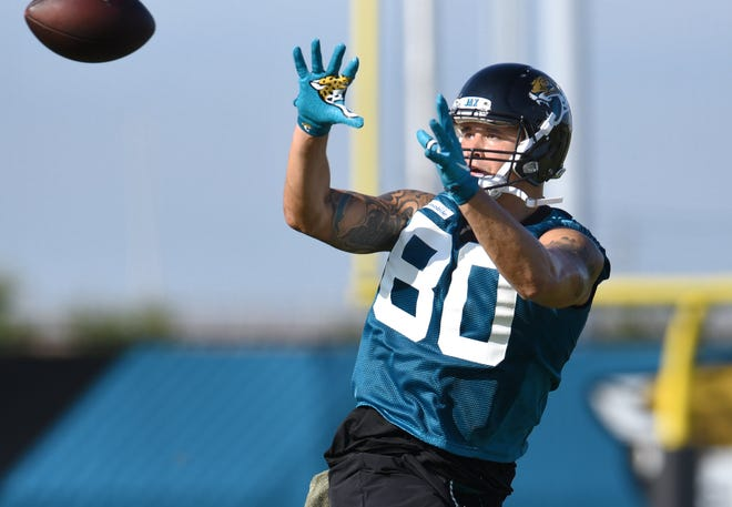 Jaguars #80, James O'Shaughnessy prepares to catch a pass during drills at Thursday morning's training camp session. The Jacksonville Jaguars training camp session on the practice fields by TIAA Bank Field Thursday morning, July 25, 2019. [Bob Self/Florida Times-Union]