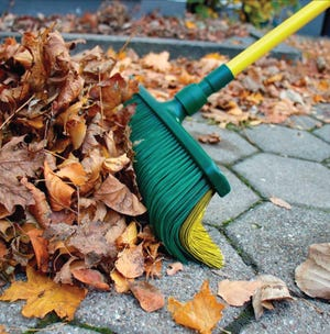 The Claw Broom combines a broom and a rake, to save hassle doing yard work.