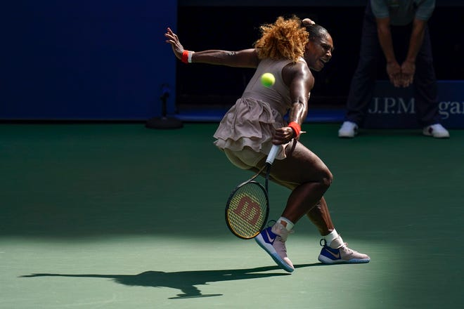 Serena Williams, of the United States, returns a shot to Maria Sakkari, of Greece, during the quarterfinals of the US Open championships Monday.