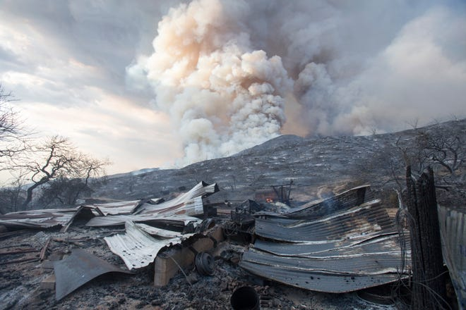 A burned structure is seen at a wildfire in Yucaipa, Calif. A couple's plan to reveal their baby's gender at a party went up in smoke Saturday at El Rancho Dorado Park in Yucaipa, when a pyrotechnical device they used sparked a wildfire that has burned thousands of acres.
