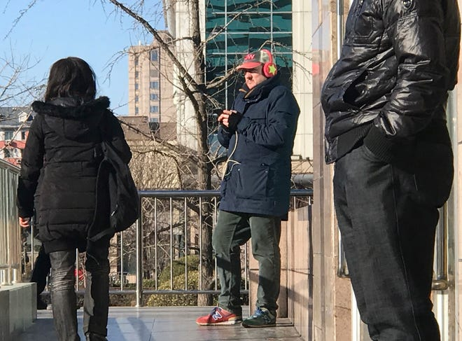 A CNN cameraman waits outside the train station in Beijing, China in January 2019. China is delaying the renewal of press cards for at least five journalists working at four U.S. media outlets, an organization of foreign correspondents said Monday, making them vulnerable to expulsion in apparent retribution for Washington's targeting of Chinese reporters working in the United States.