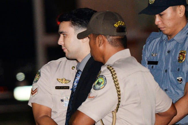 Convicted U.S. Marine Lance Cpl. Joseph Scott Pemberton is escorted to his detention cell in December 2015 upon arrival at Camp Aguinaldo at suburban Quezon city, northeast of Manila, Philippines. The Philippine president pardoned the U.S. Marine on Monday in a surprise move that will free him from imprisonment in the 2014 killing of a transgender Filipino woman that sparked anger in the former American colony.
