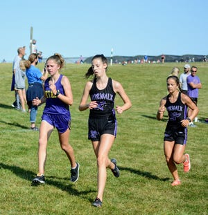 Freshman Tori Meinecke (left) took fourth in her first varsity meet for the Nevada girls' cross country team Saturday at the Dutch Invitational in Pella.