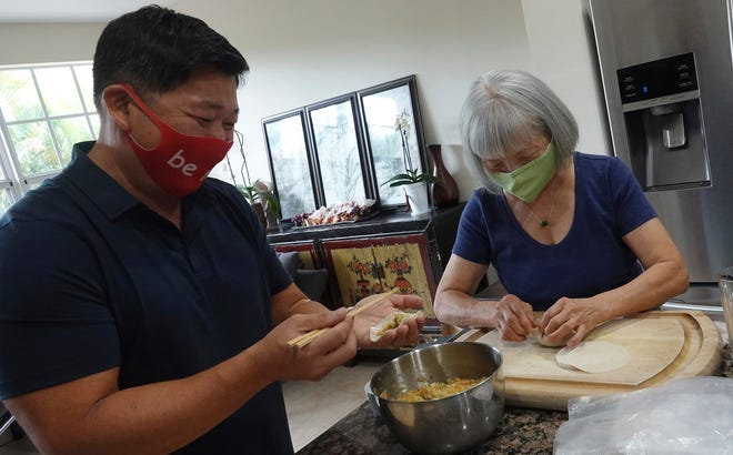 Calvin Shea and his mother Shirley Shea make dumplings during the coronavirus pandemic at their home in Fort Lauderdale on Aug. 19. What started as a way to renew their relationship after living apart for decades has turned, practically overnight, into an all-consuming dumpling business. (Joe Cavaretta/South Florida Sun-Sentinel via AP)