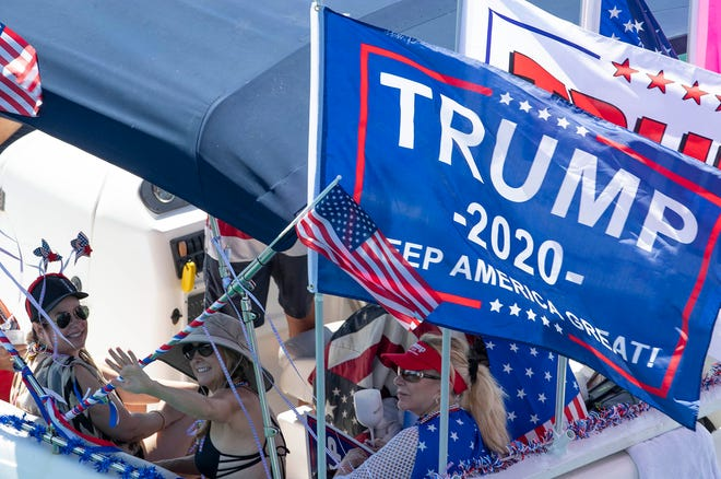 Hundreds of Trump supporters take to the Intracoastal Waterway in a show of support during a boat parade from Jupiter to Mar-a-Lago in Palm Beach, September 7, 2020. [ALLEN EYESTONE/The Palm Beach Post]